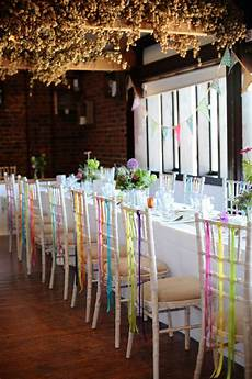 different coloured ribbon hanging from the reception venue