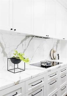 white kitchen cabinets with white backsplash 14 white marble kitchen backsplash ideas you ll