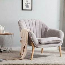 upholstered soft fabric armchair oyster scalloped back