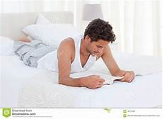reading a book on his bed stock image image 18107081