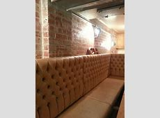 Exposed brickwork, tan leather banquette seating & industrial lighting at Jacobs Chop House