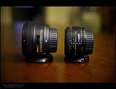 comparison in size of the nikkor 50mm 1 8g and 1 8d flickr