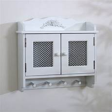 detailed white wall cabinet with hooks melody maison 174