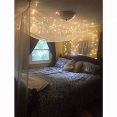 canopy bed with starry lights running all across