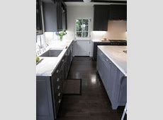 grey cabinets with dark floors   Gray cabinets, dark floors, marble counter top, subway tile