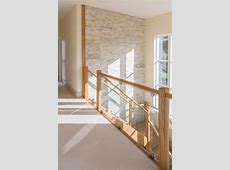 Beautiful hallway, stairs and landing. Cream quartzite splitface tiled feature wall from