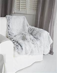 grey fur throw for bed or sofa