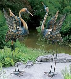 flying copper patina crane pair statue sculpture heron