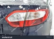 Snow Lights Car Light Ice On The Car Light Car Under The Snow Stock