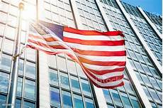 American Flag Office Floating American Flag In Front Of Office Building Sun