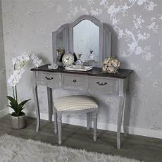 large grey dressing table mirror and padded stool