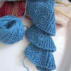 trying my at row knitting spiral scarf