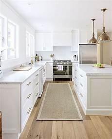 White Kitchen Cabinets Light Floor Sisal Runner White Kitchen With Carrara Marble Brass