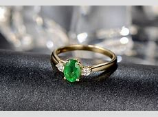 Trilogy Half Carat oval cut Emerald and Round Diamond