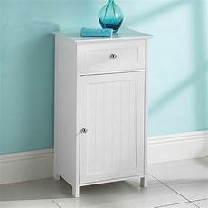 white wood free standing cupboard with a drawer bathroom
