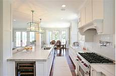 galley kitchen with island layout island wine fridge transitional kitchen charleston