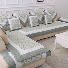 cotton blanket on the floral cover sofa cushion
