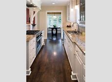 Love the dark wood floors, white cabinets, and light granite counter combination   Dream Kitchen