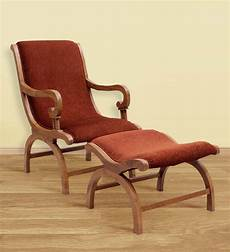 buy teak wood arm chair with leg rest in