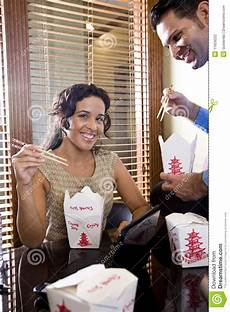 Office Takeout Co Workers In Office Eating Chinese Takeout Food Stock