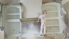 how professionals spray paint built in cabinets using