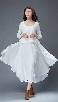 white linen dress layered flowing sleeve