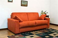 squared sofa bed upholstered in microfibre and