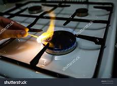 Lighting A Gas Stove Stock Photo A Man Lighting The Gas Stove With A Match