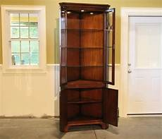 corner china cabinet with glass shelves and lighting kit