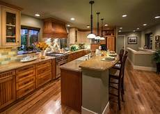 Kitchen Island Are More Practical Than Kitchen Bars This Green Country Kitchen Features A Large Kitchen Island