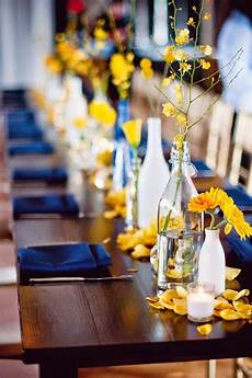 lovely yellow and blue wedding tables with rose petals