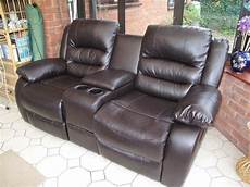 2 seater reclining sofa with cup holders and centre