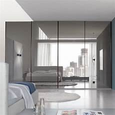 a modern minimalist bedroom design with wide