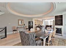 Glamorous Victorian in Yorkville: Indirect lighting highlights the oval coffered ceiling in the