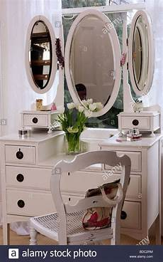 oval mirrors on white dressing table with white