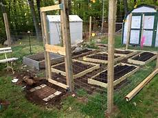 small scale garden fence with raised beds 7 steps