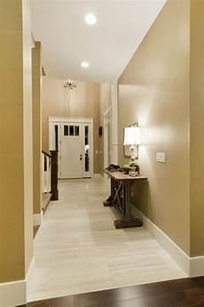 Dark Walls Light Floor Light Tile With A Seamless Transition To Dark Wood Floor