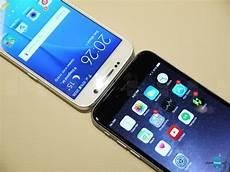 Samsung S6 Vs Iphone 6 Samsung Galaxy S6 Vs Apple Iphone 6 Plus First Look