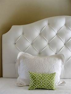 white velvet tufted upholstered headboard with