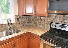tile backsplash for kitchens with granite countertops brown glass tile santa cecilia countertop