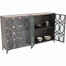 vintage iron and wood storage cabinet with glass doors at