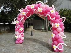 arco de globos arco de globos rosa con flores y espirales www