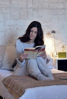 reading a book in bed photos creative market
