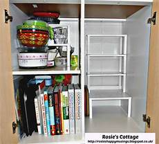 inside of ikea fyndig kitchen cabinet with variera shelf
