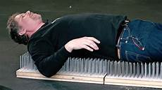 the science a bed of nails mental floss