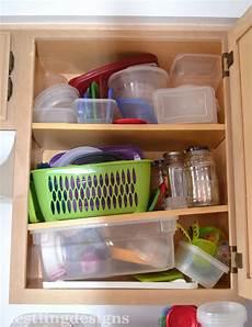 nestling kitchen organization tupperware storage
