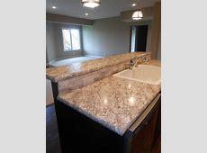 Vencil Homes   Wilsonart HD #laminate on the bar tops. Natural stone ledger panel backsplash