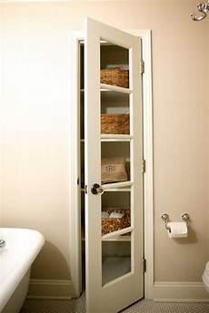 bathroom closet door ideas linen closet transitional bathroom companies