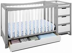 what is a convertible baby crib with changing table graco