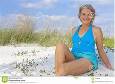 frauen am strand senior in swimming costume at stock photo